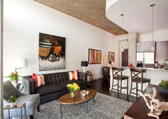 Зонування виконується за допомогою дизайну стелі, підлоги