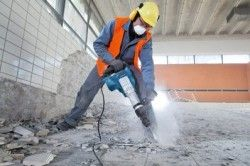 Демонтаж плитки за допомогою перфоратора або ударного дриля