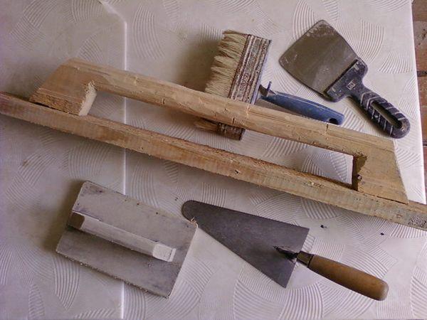 Інструменти для кладки каміна з цегли