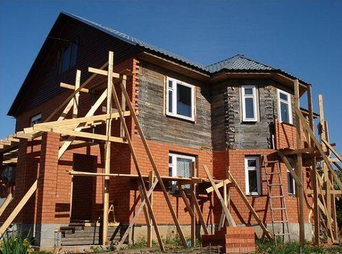 Фото - Як обкласти дерев'яний зруб цеглою