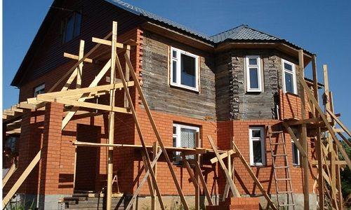Обкладання цеглою будинку з бруса