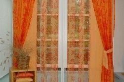 Приклад багатошарових штор на вікні