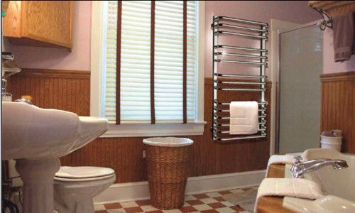 Полотенцесушитель у ванній кімнаті