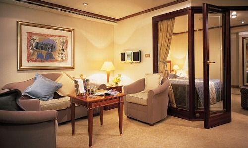 Фото - Поєднання зон: спальня плюс вітальня
