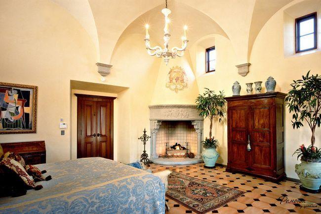 Фото - Затишний вогнище вітальні з кутовим каміном в інтер'єрі