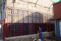 Посилення цегляної стіни армованої обоймою