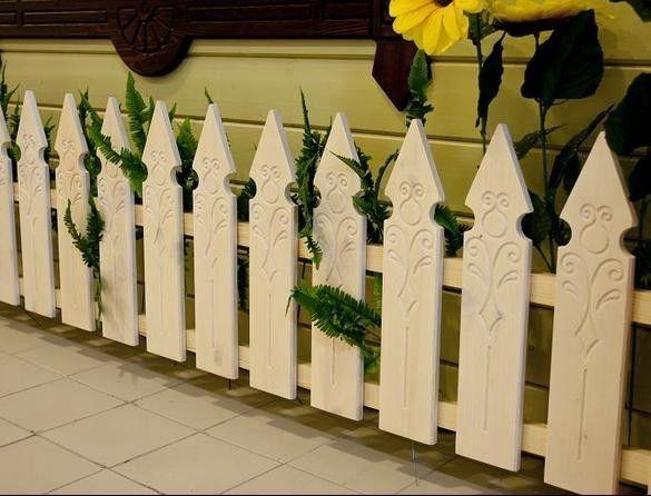 Фото - Огорожа з різьбленого дерев'яного паркану