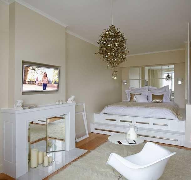 Зонування вітальні за допомогою килимів